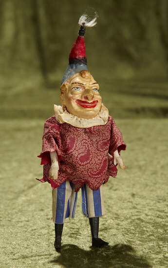 "7"" German paper mache jester with highly-characterized expression. $200/250"