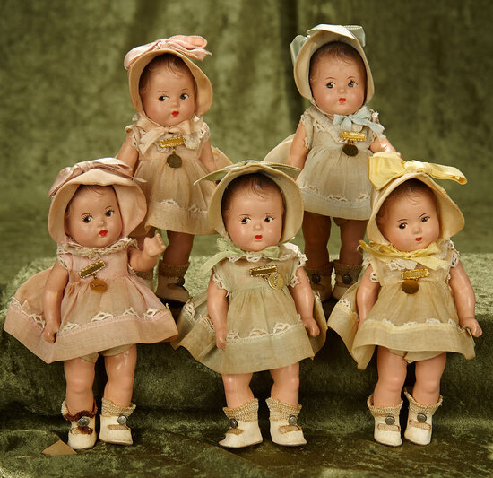 "8"" American composition set of Dionne Quintuplets in orig boxes, costumes by Alexander. $800/900"