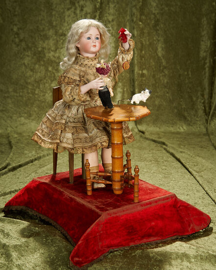 "21"" French musical automaton ""Little Girl Playing with Kitten"" by Leopold Lambert. $6000/7000"