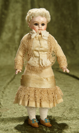 """10"""" German paper mache doll attributed to Schilling with beautiful original costume. $300/400"""
