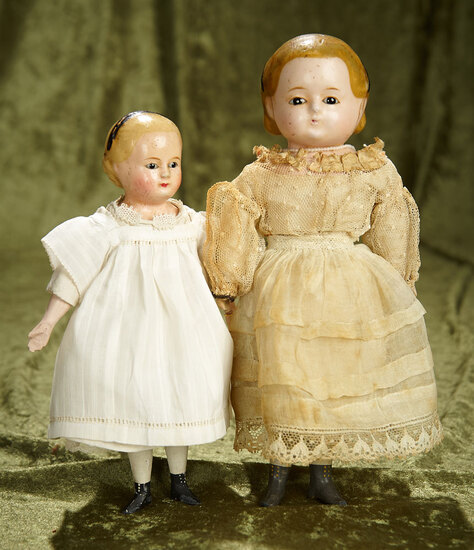 """8"""" and 10"""" Two German wax-over-paper mache taufling glass-eyed dolls. $500/700"""