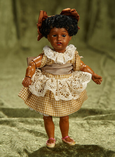 """7"""" German brown-complexioned child doll, 34 16, by Gebruder Kuhnlenz. $400/500"""
