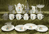 Doll-Size German porcelain tea service, Greenaway-like images, and various glassware. $400/500