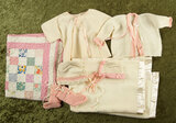 Knit costume for baby doll along with handmade quilt. $300/400