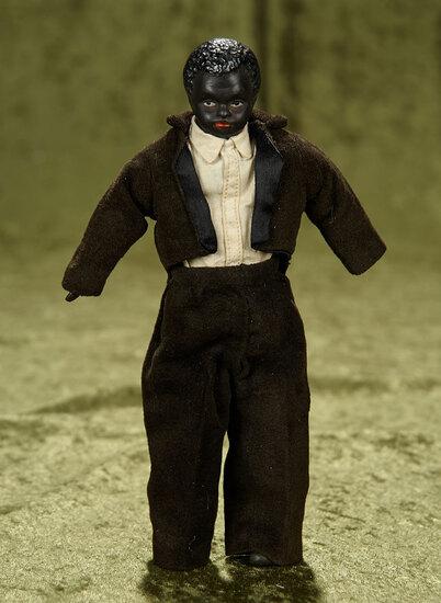 "9"" German bisque dollhouse man with black complexion, antique costume. $400/500"