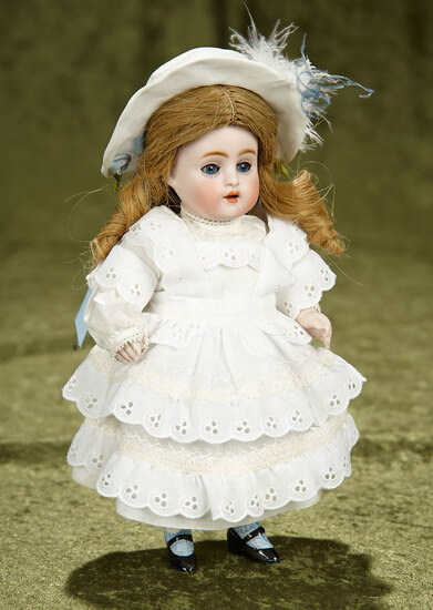 """8"""" German all-bisque miniature doll by Kestner with painted blue stockings. $400/500"""