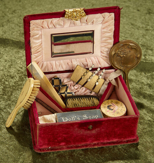Velvet box of miniature doll accessories and toiletries. $400/500