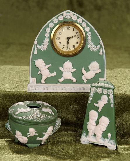 """5 1/2"""" clock. Three German bisque Kewpie novelties. $500/700"""