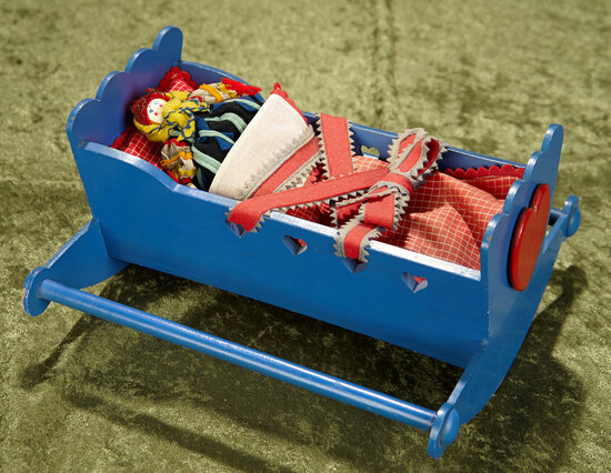 """10""""l. Italian novelty baby in wooden decorated cradle by Lenci. $800/1000"""