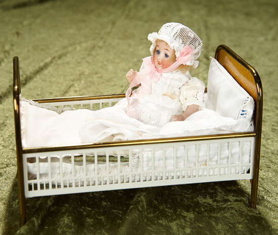 "5 1/2"" German all-bisque baby in brass and metal tin bed, possibly Maerklin. $500/700"