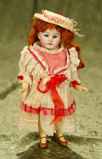 "8"" German bisque flapper child by Simon and Halbig. $400/500"