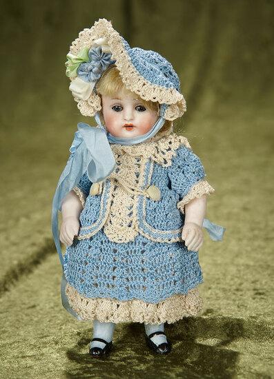 "7"" German all-bisque miniature doll, model 150, by Kestner. $300/400"