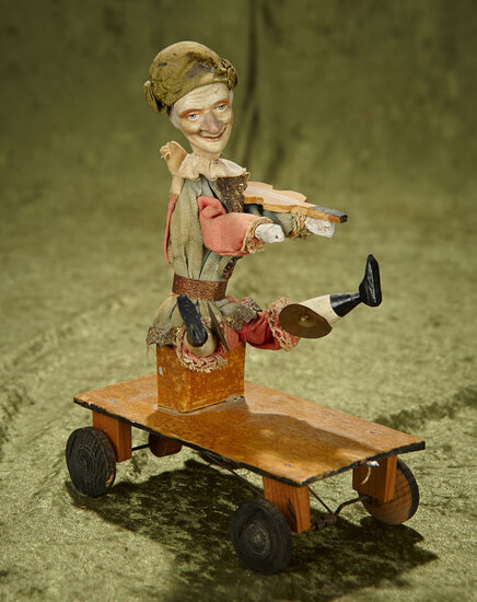 "9"" Sonneberg paper mache pull-toy mechanical clown with amusing action. $400/500"