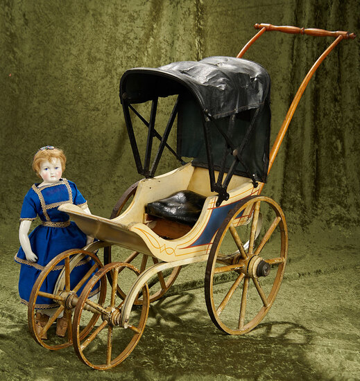 "34"" (including handle). American wooden doll carriage by Joel Ellis, original finish. $500/700"