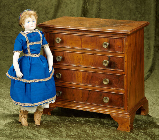 "14"" x 14"" Four drawer doll chest of fine burled woods in Chippendale style. $400/500"