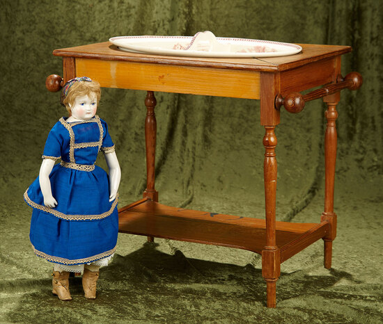 "21""w. x 17""h. French wooden child-size toilette table with softpaste bowl. $400/500"