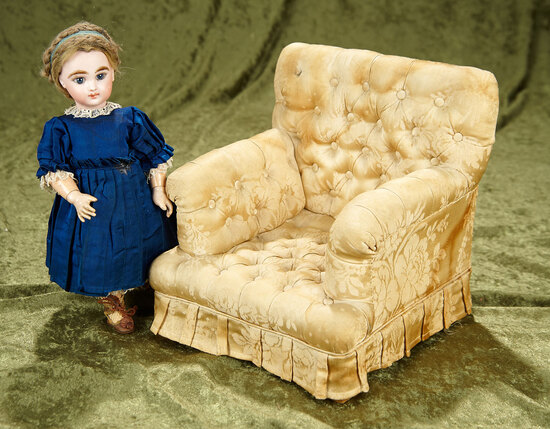 "9""h. 9""d. 8""w. Doll's arm chair with richly-tufted silk upholstery. $400/500"