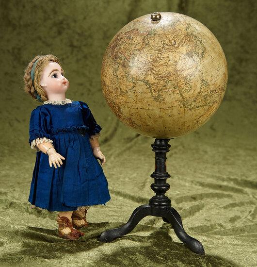 "13"" Revolving globe on tripod pedestal base. $500/700"