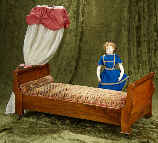 "28""l. 23""h. French mahogany doll's bed with canopy top. $400/500"