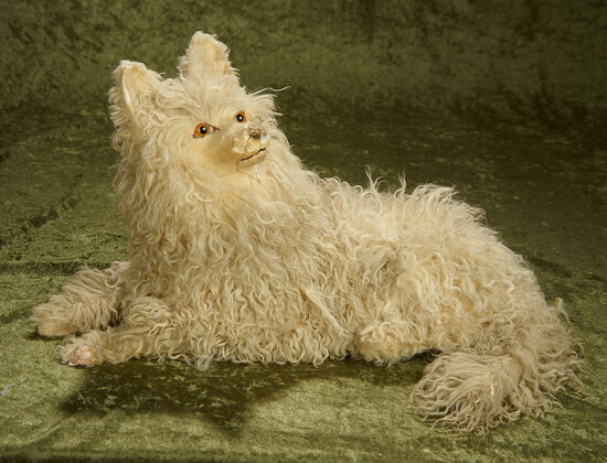 "10""l. French paper mache and curly lambswool salon dog for display. $400/500"