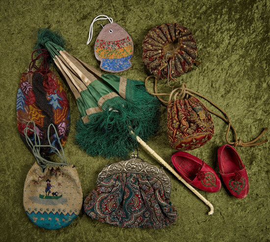 Lady's early needlework beaded purses, bone-handled parasol, and rare kidskin slippers.  $400/500
