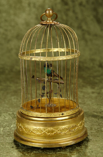 "11"" Swiss Mechanical Singing Bird in Gilded Cage by Reuge. $600/900"