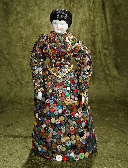 "25"" German porcelain china doll with unique ""Button Gown"". $400/500"