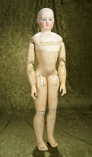 "34"" French bisque poupee with rare all-wooden fully-articulated body. $2000/2500"