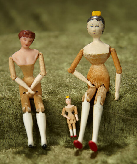 "3/4"" - 3 1/2"". Three American wooden miniature dolls, possibly Sherman Smith. $200/300"