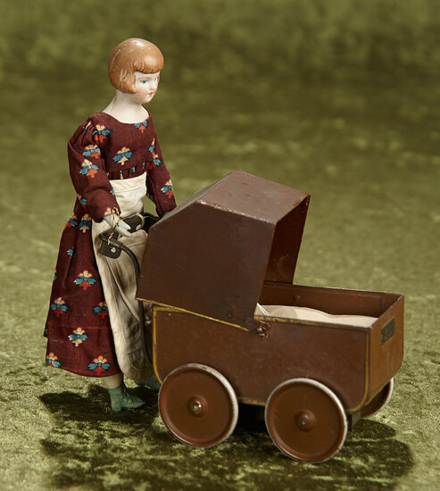"7"" German mechanical toy of bisque lady pushing a tinplate baby carriage. $300/400"