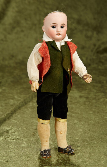 "12"" German bisque boy, excellent bisque, composition body in a nice European outfit."