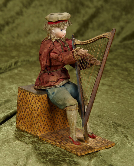 """9"""" German hand-wind bisque boy as harpist, wooden limbs, with original frail outfit."""