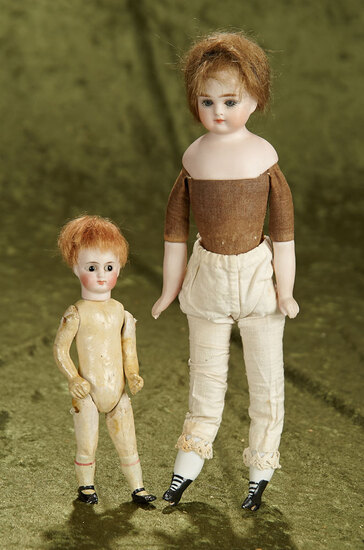 "11"" Pair of small German bisque shoulder dolls, one marked 3, and the other is Limbach."