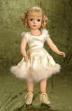 Vintage hard plastic doll in original tagged skating costume by Alexander.