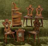 Six piece lot of German wooden dollhouse furniture with hammered design including four chairs.
