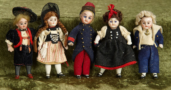 "Five 3 1/2"" German all-bisque miniature dolls with factory original costumes. $500/700"