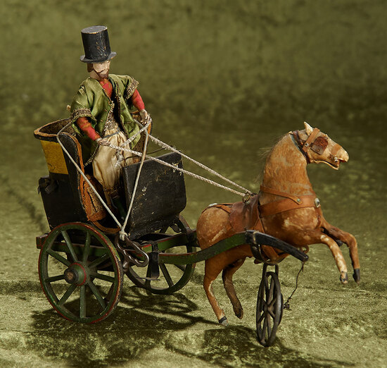 "13""l. Early mechanical wheeled toy ""Horse with Two-Wheeled Cart"" and wooden man. $800/1100"