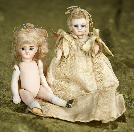 "Two 4"" German all-bisque mignonettes with cobalt blue eyes. $500/700"