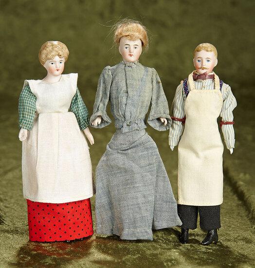 "Three 7"" German bisque dollhouse dolls in original costumes. $400/500"