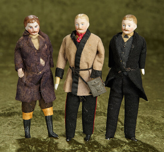 "Three 7"" German bisque dollhouse gentleman with moustaches, original costumes. $500/700"