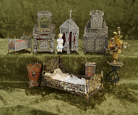 "5 1/2""l. bed. Collection of German soft-metal dollhouse furnishings and accessories. $400/600"