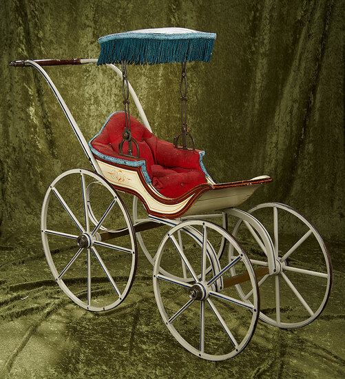 "39"" American wooden doll carriage attributed to Joel Ellis, original stencilling, sunshade. $500/600"