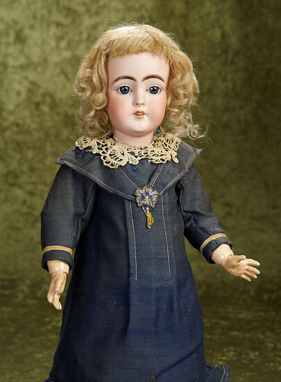 "18"" German bisque child by Simon and Halbig with original wig and body. $400/500"