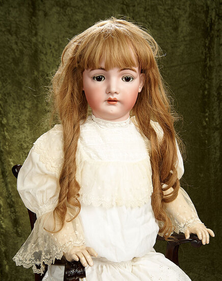 "40"" Grand German bisque child with brown glass sleep eyes by Kammer and Reinhardt. $1600/1900"