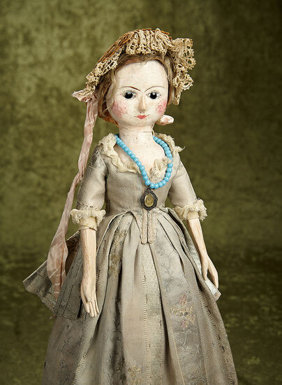 "18"" Early English wooden doll with enamel eyes, antique costume $5000/7000"