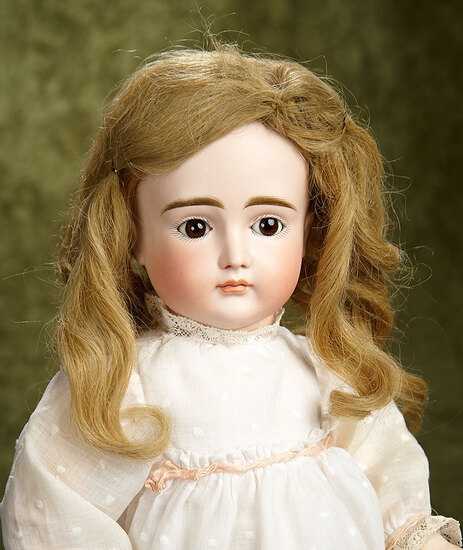 "19"" German bisque closed mouth child doll by Kestner, original body. $1200/1500"