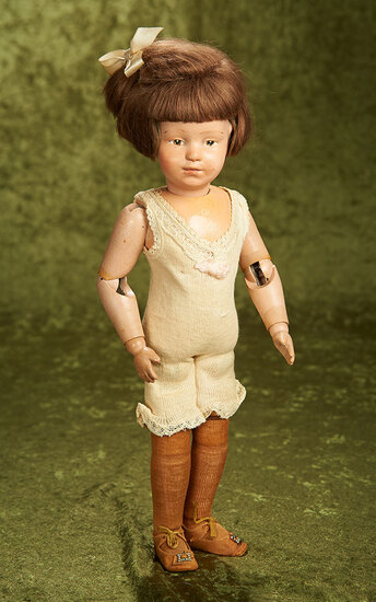 "15"" American wooden pouty-faced girl by Schoenhut with original shoes. $400/600"