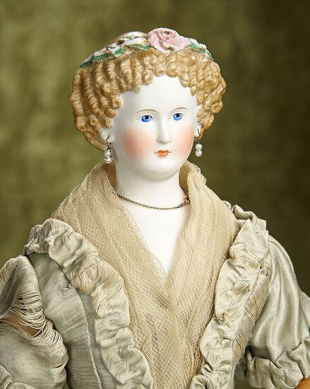 "20"" German bisque lady doll with sculpted brown hair and Dresden coronet. $600/800"
