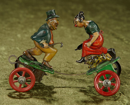 "7""l. German tin mechanical lithographed toy ""Maggie and Jiggs"" by Einfalt. $500/700"