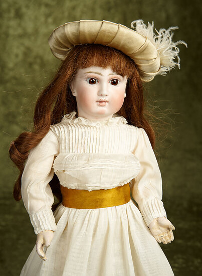 "18"" Sonneberg bisque closed mouth doll in the French manner. $700/900"